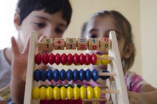 Children behind abacus