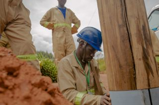 Charles Ahumuza works as an electrical engineer with Team Muttico,Technical Services Uganda. He is pictured in Kampala, working with his team to replace an old electrical pole.
