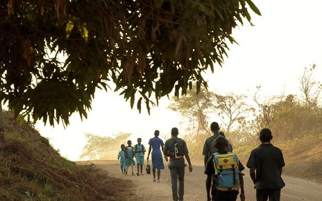 Children walk to school in the morning in the town of Yoko, Cameroon