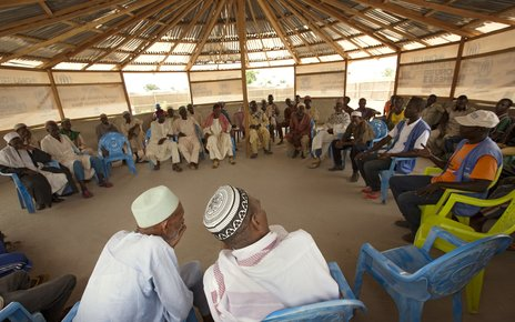 Social workers advocate against child marriage during a meeting in the Gado refugee camp