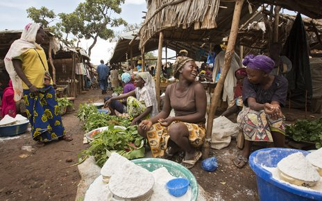 Women sell home-grown vegetables and cassava flour at the market in the Gado refugee camp, Cameroon